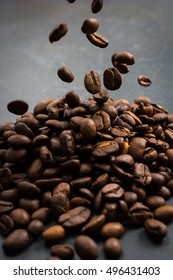 Pile of Roasted Coffee Beans with Falling Beans