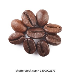 A pile of roasted coffee beans isolated on white background. Close up.