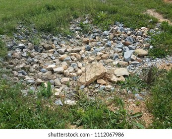 pile of rocks in the grass