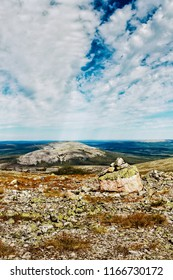 A pile of rocks on top of the Ylläs fjell in the Finnish Lapland. There's quite a view up there.