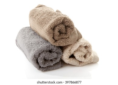 Pile of rolled towels over white background