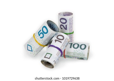 Pile of rolls of polish zloty banknotes of various denominations tied with rubber bands isolated on white background with clipping path.