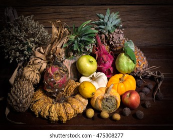 Pile rot and withered of fruits in the night on old wooden plate / Still life and vignette style