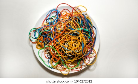 Pile of rubberbands on a plate