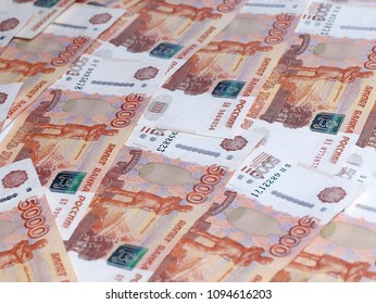a pile of Russian paper denominations with a nominal value of five thousand rubles