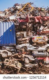 A pile of rusty cars in the Junkyard.