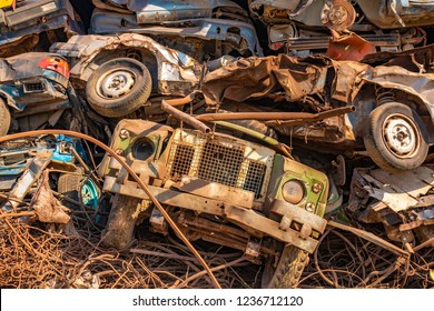 A pile of rusty cars in the Junkyard.