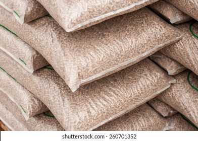 Pile of sacks of pellets, which are stacked on pallets
