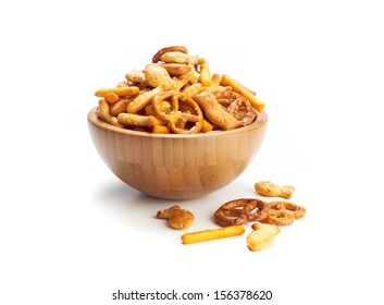 A pile of salted mixed party snacks background.