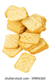Pile of salty crackers isolated on white background