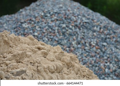 A pile of sand and gravel nearby, before building
