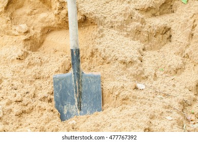 Pile of sand and shovel for construction. Outdoor. Summer.