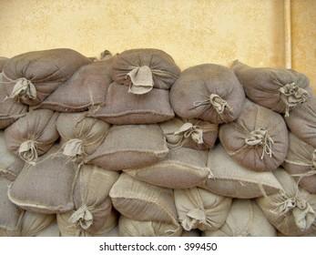 A pile of sandbags near the beach