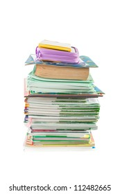 Pile of school books and writing-books with a case above isolated on a white background