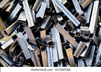 Pile of scrap metal. Rusty metal pipes and fillings. Materials for recycling from manufacturing process.