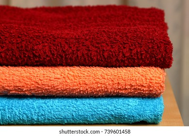 Pile of several colored towels.