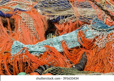 A pile of several colourful fishing nets and buoys in the harbour of Urk, The Netherlands.