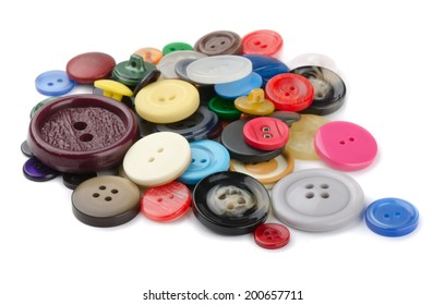 Pile of  sewing  buttons isolated on white