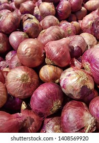 Pile of shallot in fresh market. Shallot for food ingredient.Background and texture of shallot.