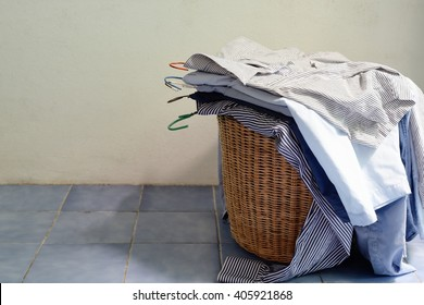 Pile of shirt in a wooden basket