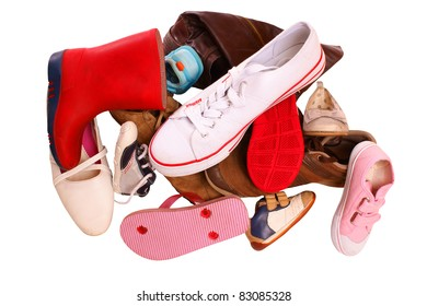 Pile of shoes, isolated against background