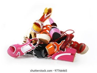 pile of shoes on white background