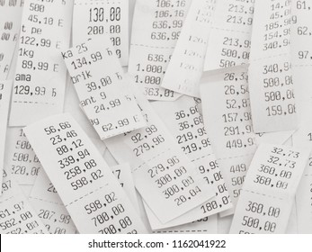 pile of shopping receipts with costs