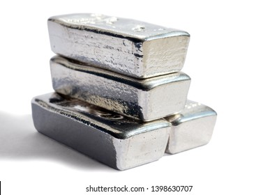Pile silver bullion isolated on white background. Selective focus.