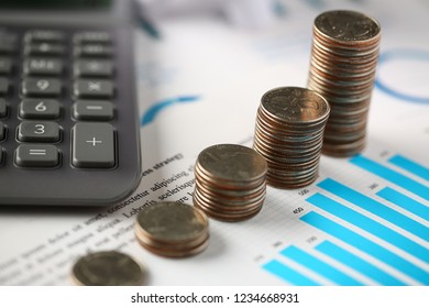Pile of silver coins stand at financial graph papers closeup. Count loan and credit price sale form review irs investigation progress assessment information concept