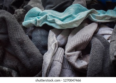 A pile of single, unmatched socks.