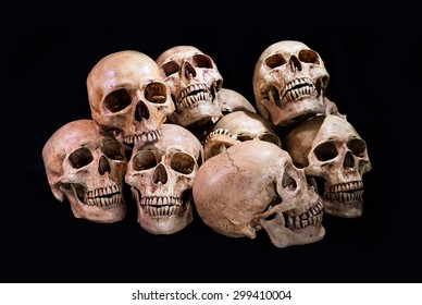 Pile of skulls on dark background, Still life style