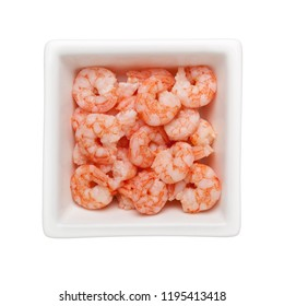 Pile of small cooked shrimps in a square bowl isolated on white background