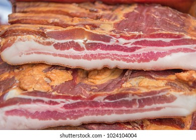 Pile of smoked bacon, shallow focus
