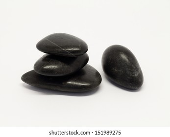 Pile of smooth lava stones on white background