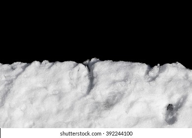 Pile of snow isolated on black