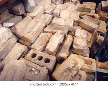 Pile of soft yellow bricks at a salvage yard in the UK.