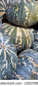 A pile of speckled blue pumpkins at a greengrocers.