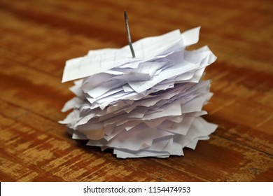 pile of spiked papers