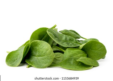 Pile of spinach leaves isolated on a white.