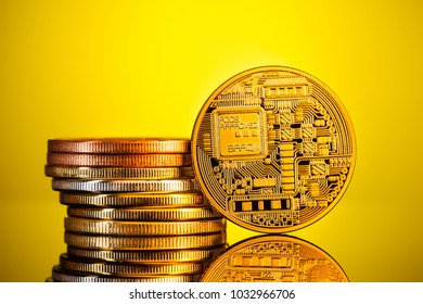 a pile or stack of bitcoin physical golden coins over a yellow background. Bitcoin is a digital cryptocurrency