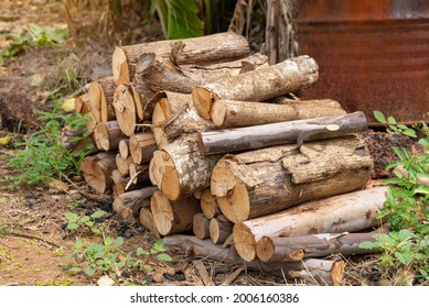 A pile of stacked firewood, prepared for heating the house, Firewood harvested for heating in winter, Chopped firewood on a stack, Firewood stacked and prepared for winter Pile of wood logs.