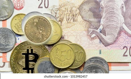 Pile Of Stacked us dollar, euro Coins, Gold Bitcoin On Top Of South Africa Banknote Background, Use As Business And Finance Concept.