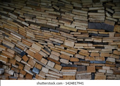 A pile of stacked wooden planks