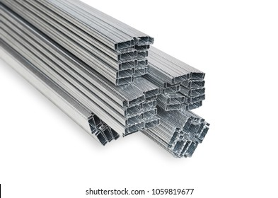 Pile of steel studs or Drywall Steel Studs isolated on white background. Steel studs for framing internal gypsum wall partition