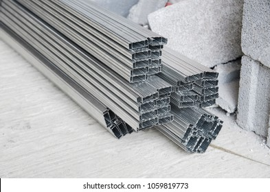 Pile of steel studs or Drywall Steel Studs on construction site background. Steel studs for framing internal gypsum wall partition