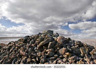 pile of stones against a cloudy sky
