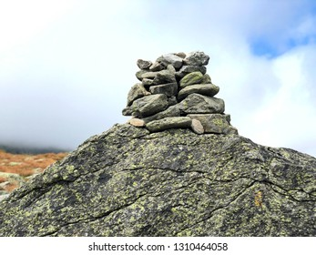 A pile of stones become a cairn as a marker on the trail to the summit of Mt. Washington in the White Mountains of New Hampshire United States.