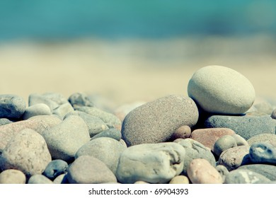 pile of stones isolated on a blur sea background with sunlight