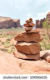 a pile of stones in Monument Valley at the Artist's Point