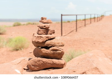 a pile of stones near fence in Monument Valley at the Artist's Point